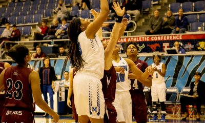 Freshman Alana Davis under the basket for U of M