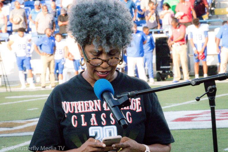 Pastor Rosalyn Nichols recites prayer before Southern Heritage Classic kickoff.