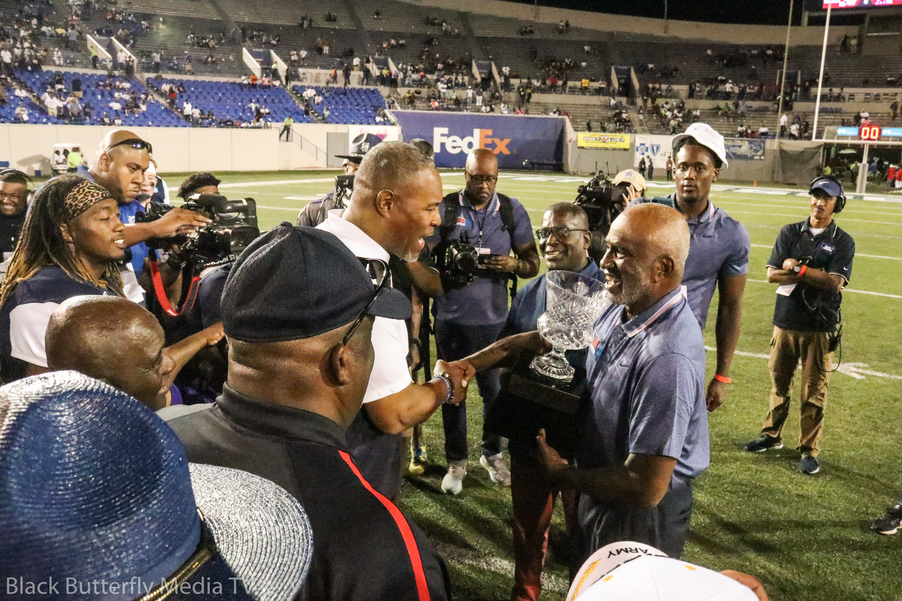 Fred Jones congratulates JSU coach John Hendrick on win