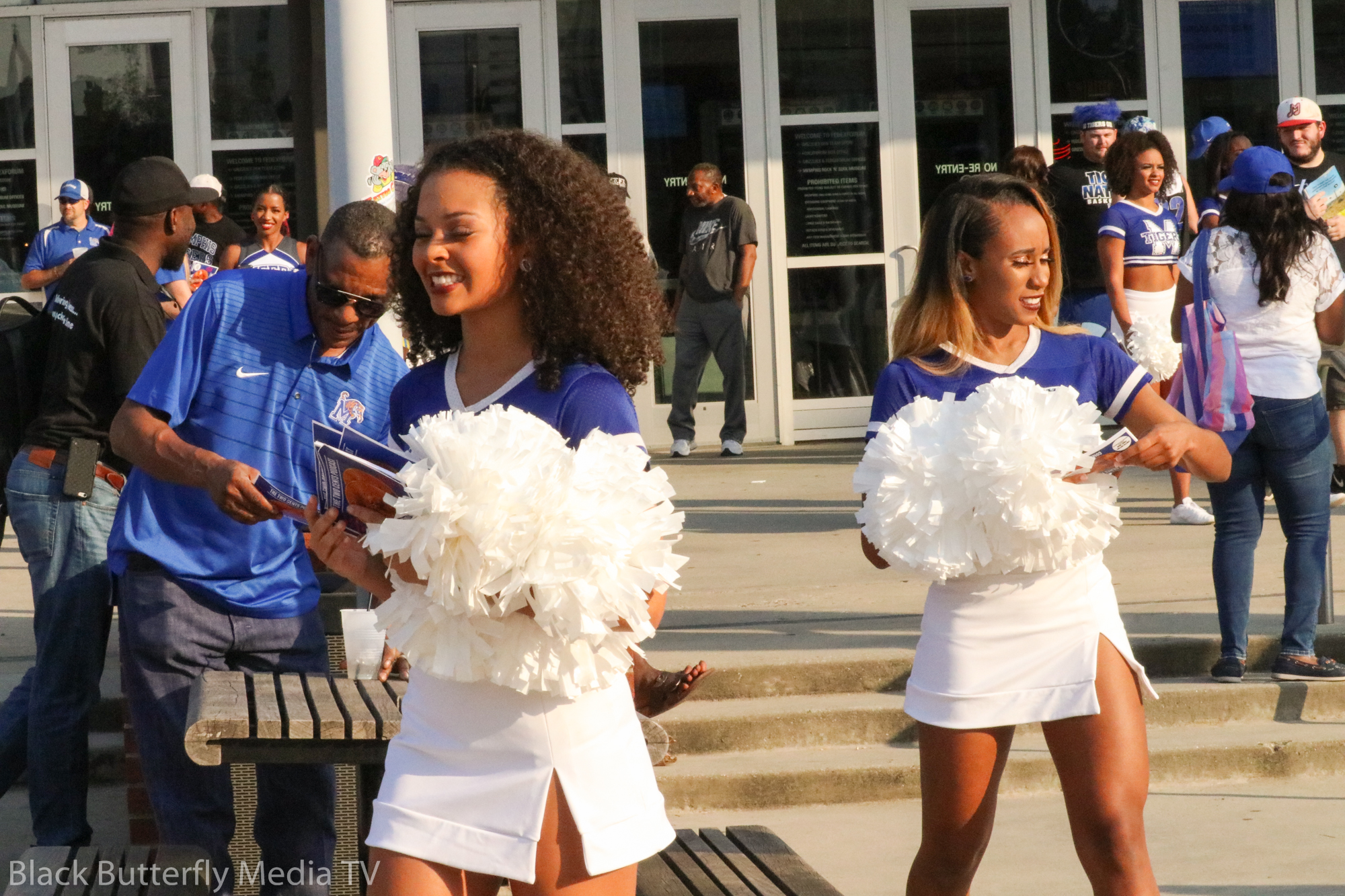 U of M Cheer Squad handing out flyers.