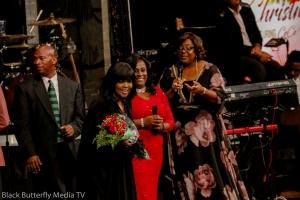 Sherry Mackey and Tracy Bethea presents roses to CeCe Winans.